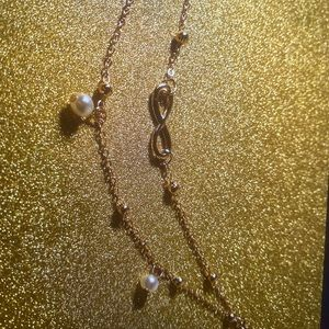 A gold infinity anklet